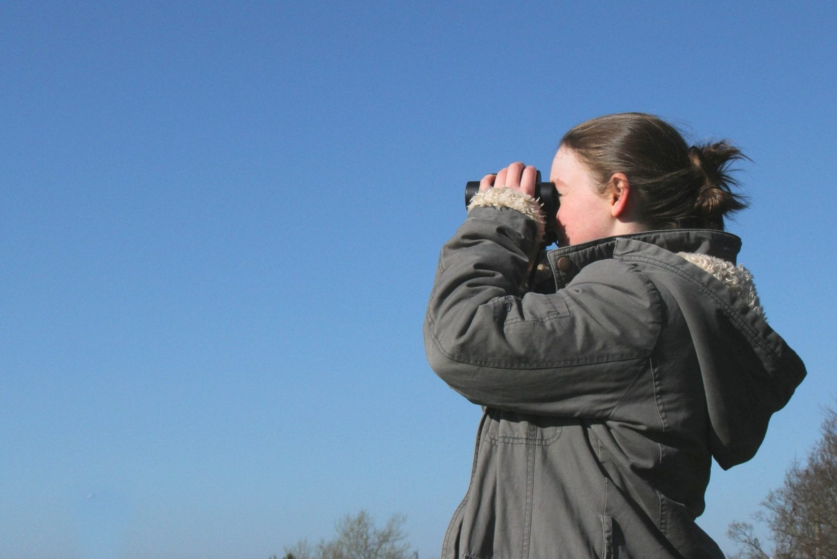 Girl-looking-through-binoculars